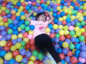 My daughter rolling in one of Zoofari's ballpits